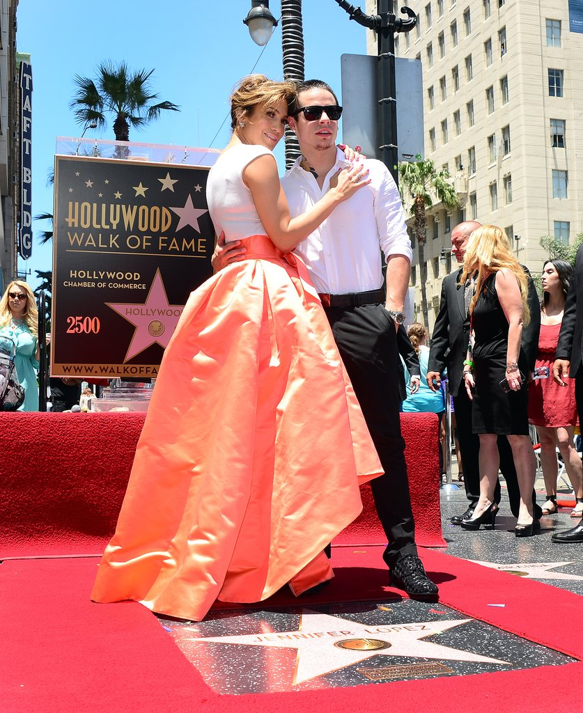 Jennifer Lopez posed with her boyfriend, Casper Smart, after getting her Hollywood star.