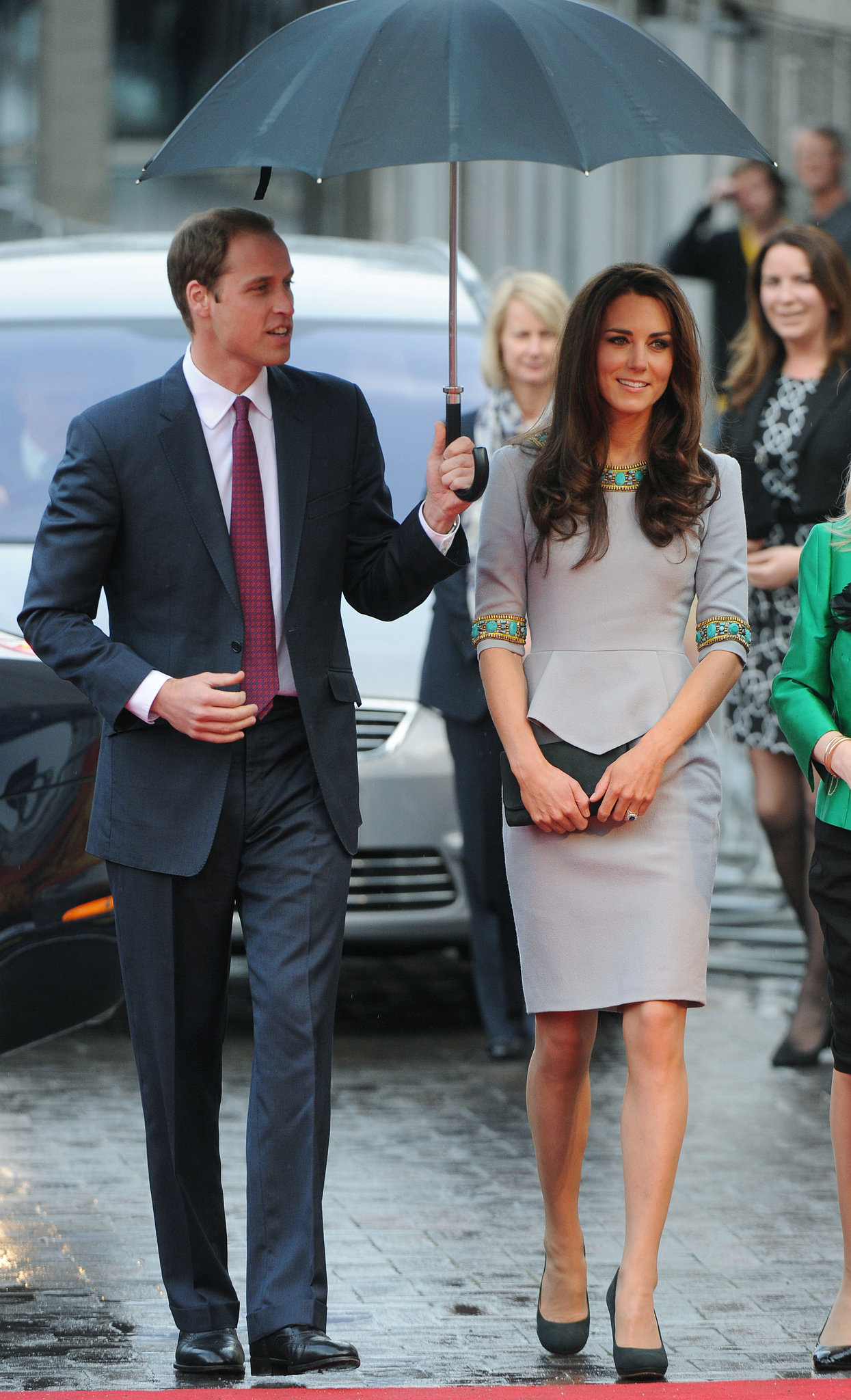 William held an umbrella over Kate's head while heading into a London theater in April 2012.