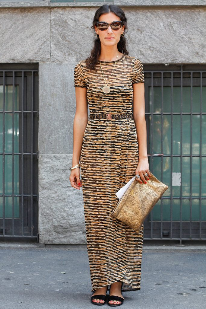 She furthered the '70s vibe of her knit maxi dress with a gold pendant necklace and a metallic Prada clutch in hand.