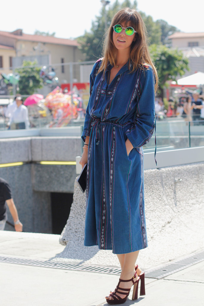 With mirrored shades to counter a vintage-feeling dress, this showgoer made a statement outside the tents in Florence.