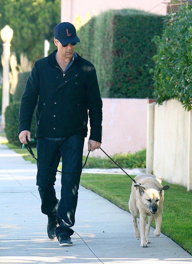 Jon Hamm took his dog for a neighborhood walk in LA in December 2011.