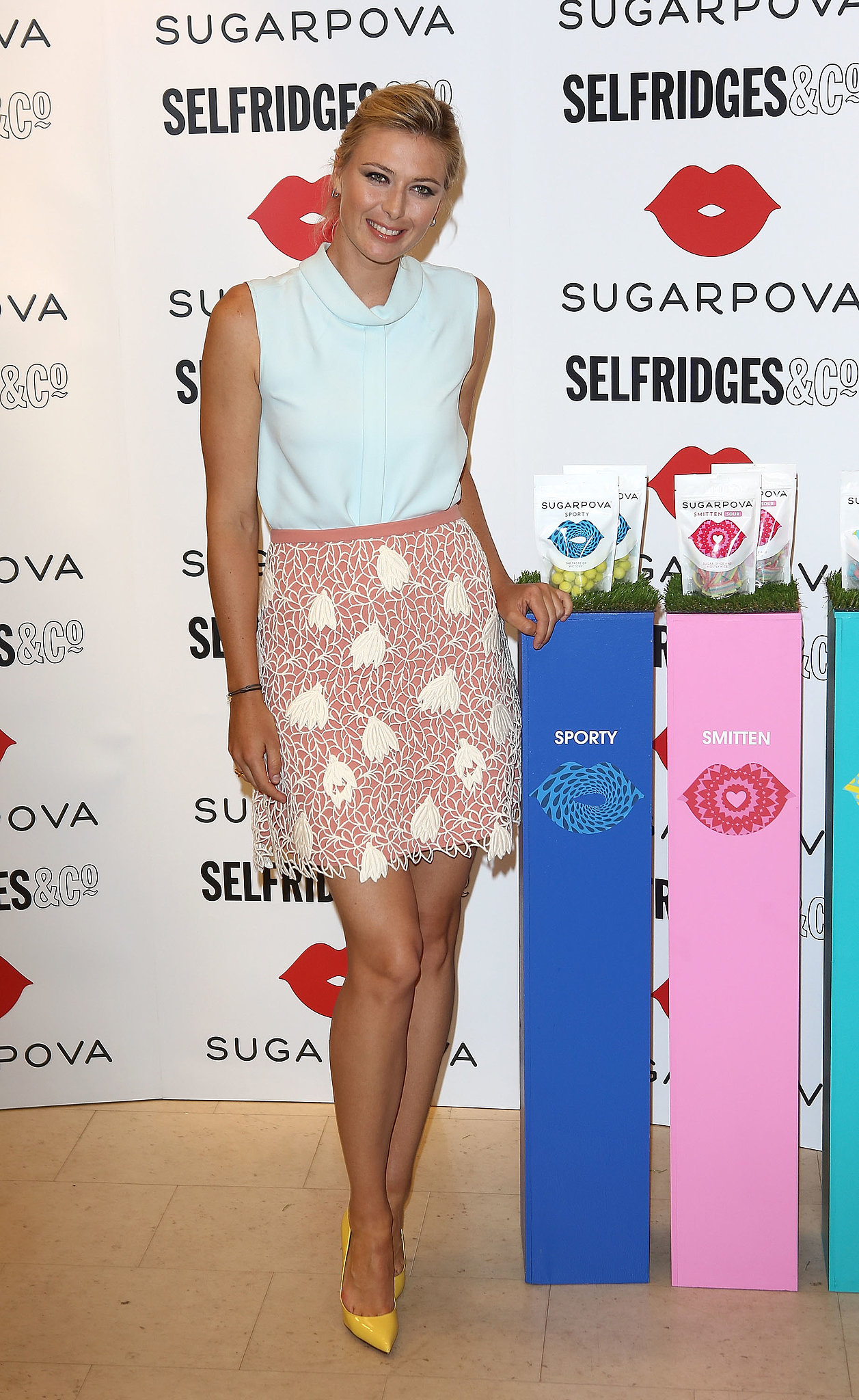 Maria Sharapova tucked a minty top into a textured miniskirt and added yellow pumps at the Sugarpova candy collection launch at Selfridges in London.