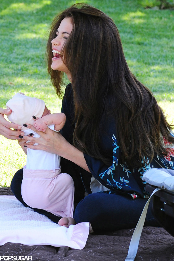 Selena Gomez held her baby sister, Gracie Elliot, in LA.