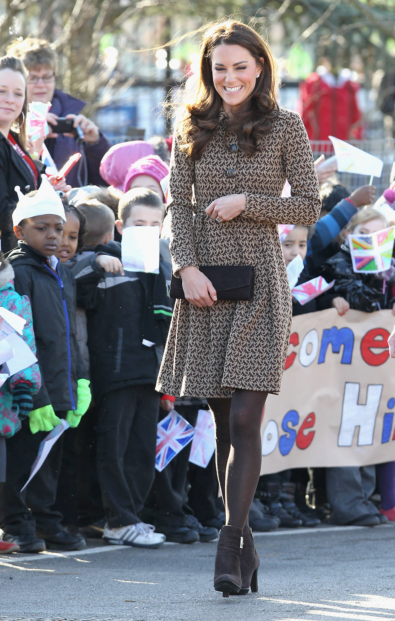 She got a giggle while visiting the Rose Hill Primary School in Oxford, England, in February 2012.