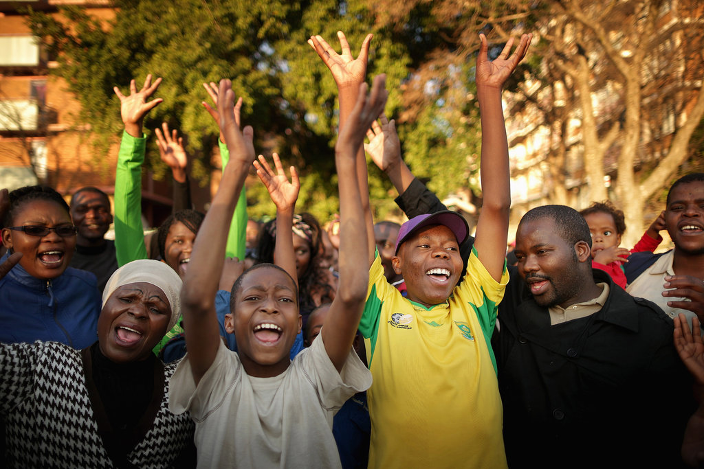 Supporters cheered after singing the South African national anthem outside the hospital.