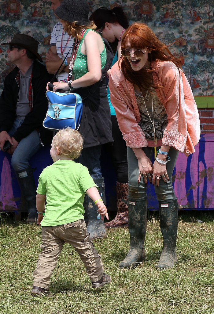 Florence Welch laughed with a friend's baby.