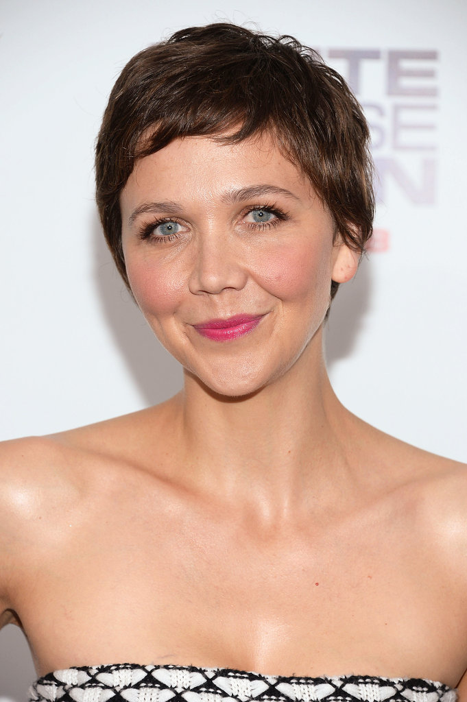 """Maggie Gyllenhaal attended the premiere of White House Down earlier this week, and makeup artist Molly R. Stern created her fresh look. """"I wanted her skin to be flushed and healthy with a pop of a lip and a whole lot of lashes,"""" she said. To achieve this, Stern used Flower Beauty Lip Color in Sweet Peony ($7) on Maggie's lips and then added a burst of color by applying Flower Beauty Lip Color in Petunia Petals ($7) just in the center. """"For her lashes I layered By Terry Mascara in Black and Brown ($40 each),"""" she said."""