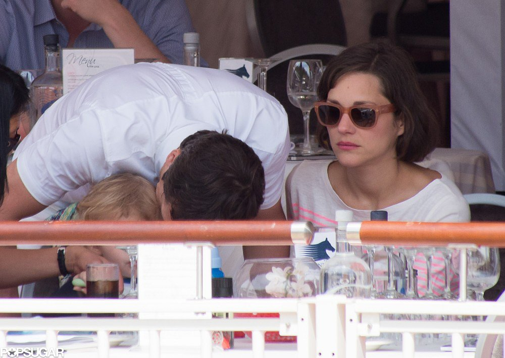 Guillaume Canet and Marion Cotillard showered their little one, Marcel, with kisses at the Monaco Jumping Show.