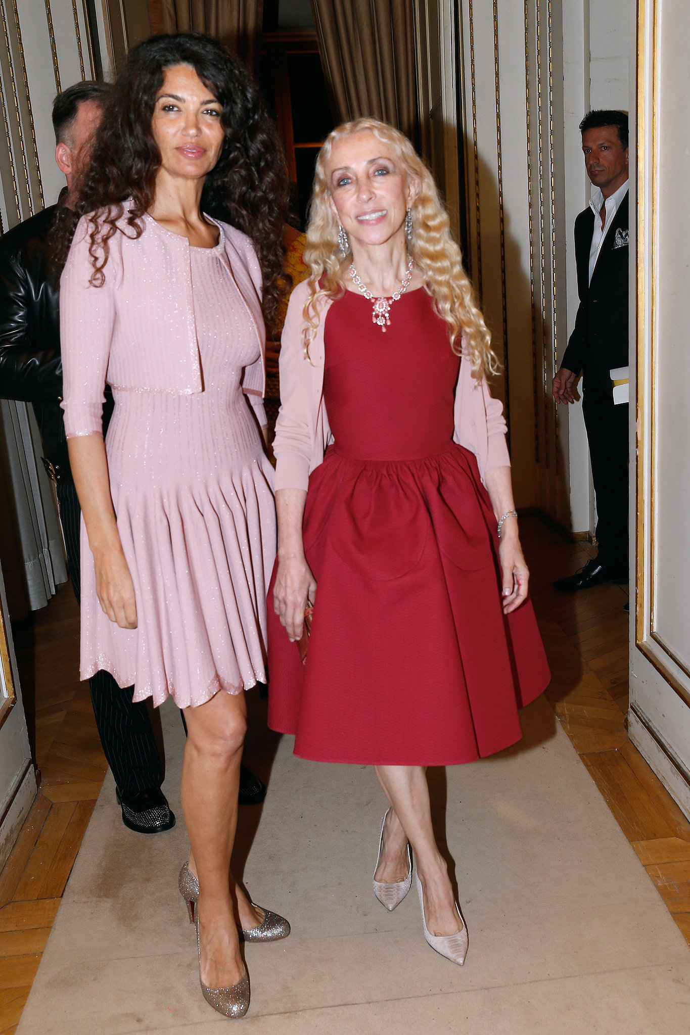 Afef Jnifen and Franca Sozzani made an entrance for the Atelier Versace runway show in Paris.