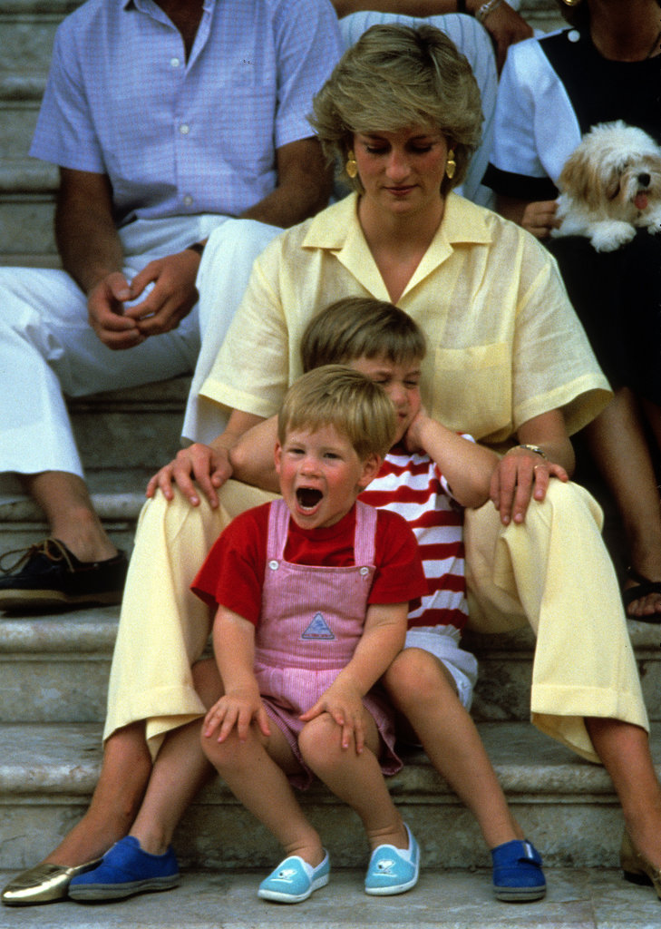 Princess Diana sat with Prince Harry and Prince William while on holiday in Majorca, Spain, in August 1987.