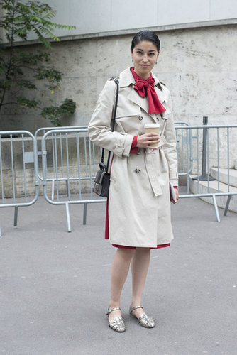 There's something so retro about Caroline Issa's buttoned-up trench over a bow-neck blouse.