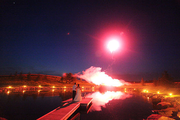The dazzling display took place over the water. Photo by A Simple Photograph via Style Me Pretty