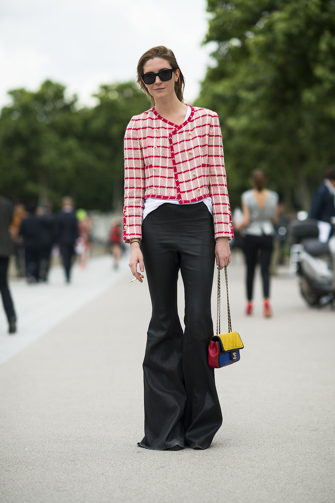 This showgoer topped her dramatic flares with a little Parisian flair — a tweedy jacket for just the right chic finish. Source: Le 21ème | Adam Katz Sinding