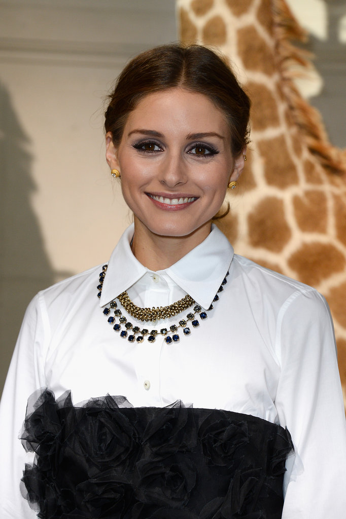Always a class act, Olivia Palermo went for her signature center part and simple eyeliner at Valentino.