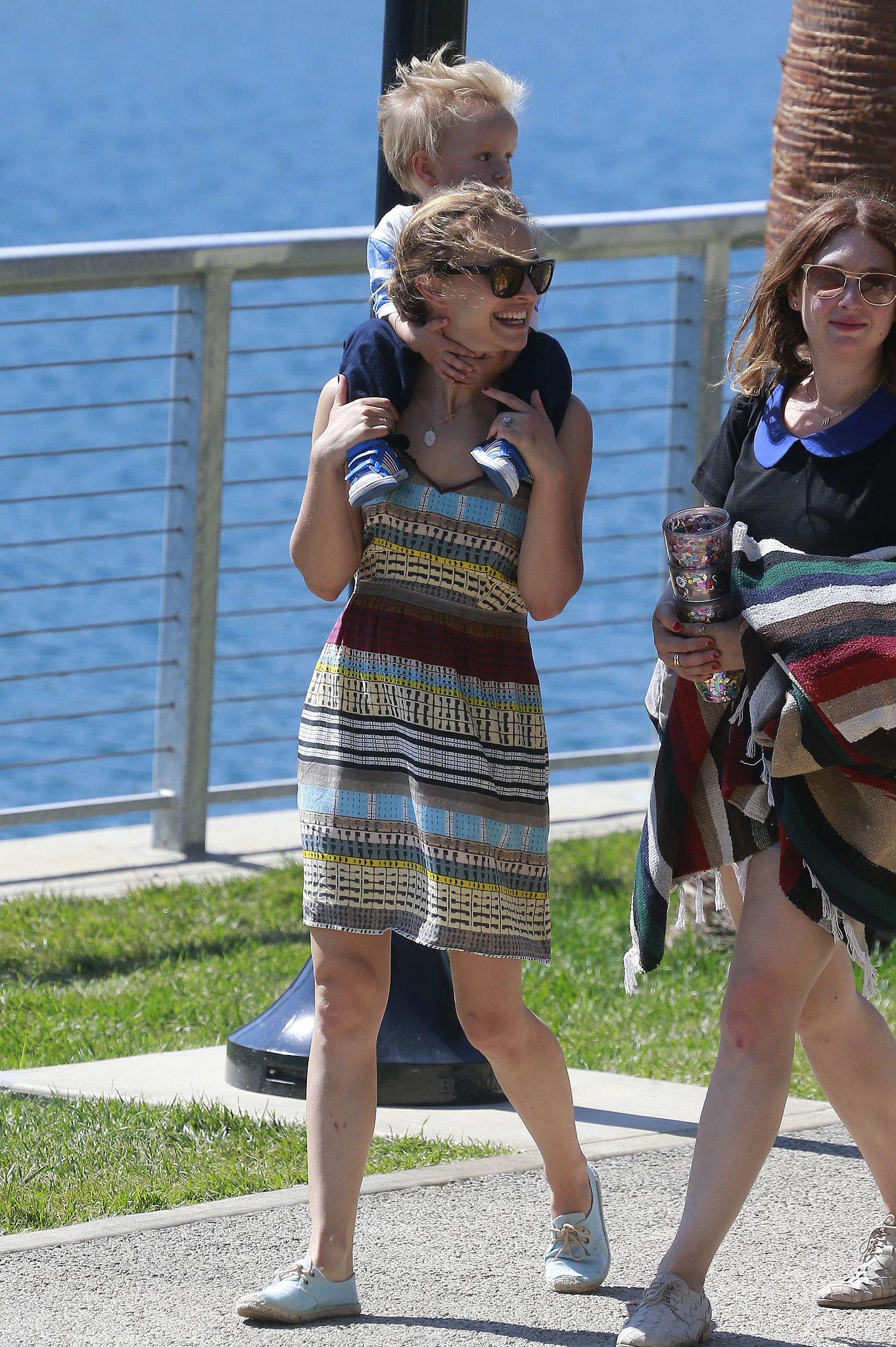 Natalie Portman carried her son on her shoulders.