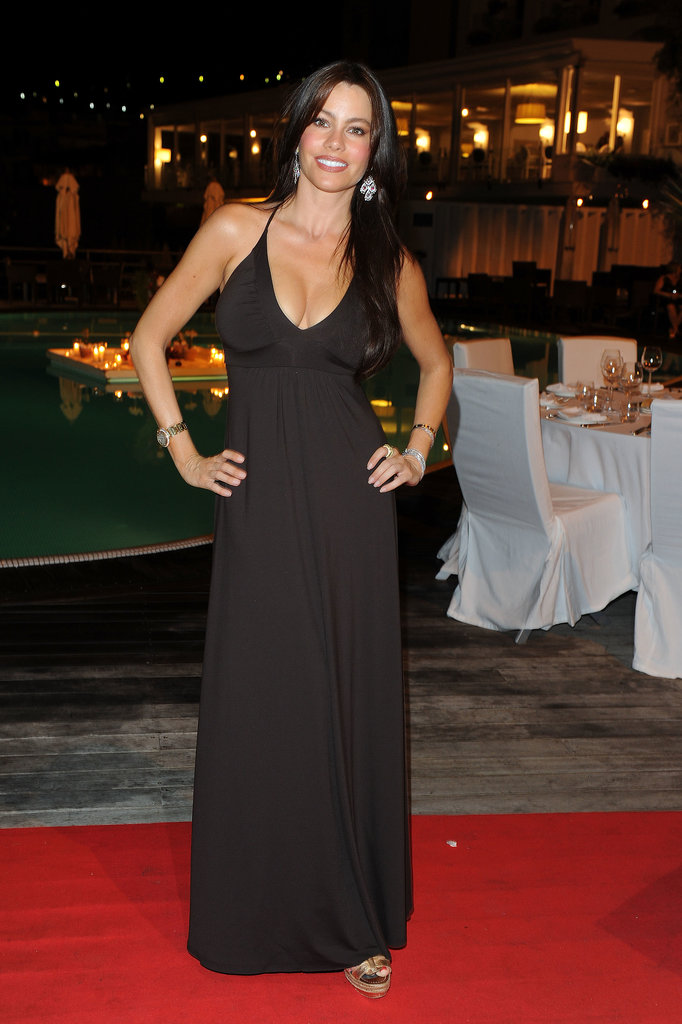 A simple black maxi dress, metallic sandals, and a few gleaming jewels rounded up Sofia's July 2010 look in Ischia, Italy.