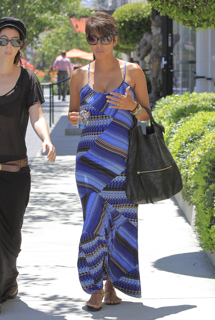 On a sunny day in LA, Halle stood out in a bold blue printed maxi dress, an oversize black bag, and beaded bracelets for an earthy finish.