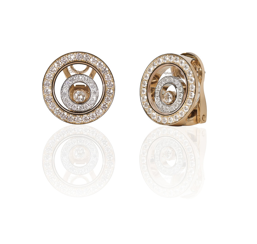 Chopard Happy Spirit collection earrings, featuring floating diamonds in an 18-karat white and 18-karat yellow gold earring. Source: Chopard