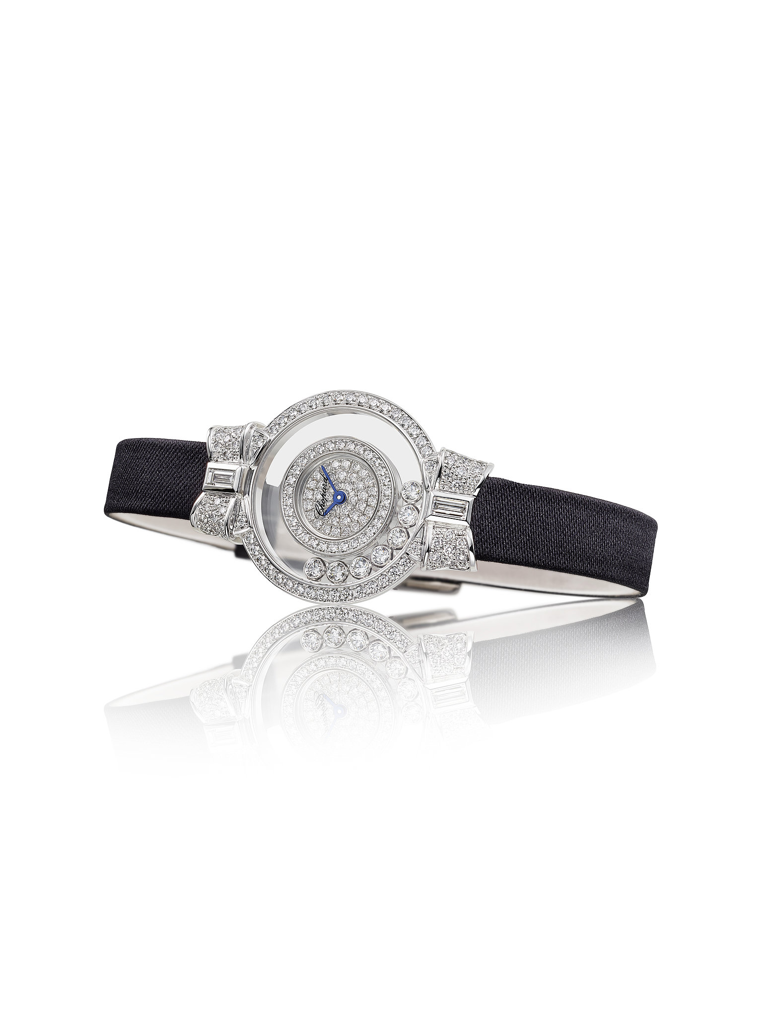Chopard Happy Diamonds collection diamond timepiece, featuring a baguette and brilliant-cut white diamond face set in 18-karat white gold on a black satin strap. Source: Chopard