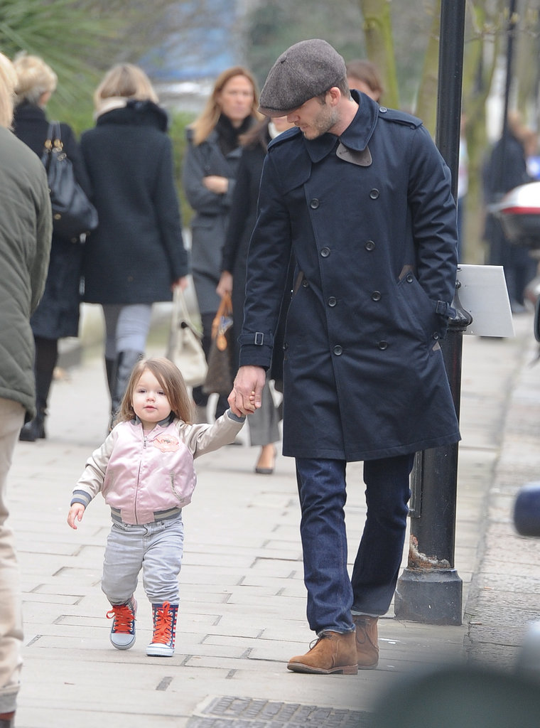 Harper held David's hand while walking through Kensington in March 2013.