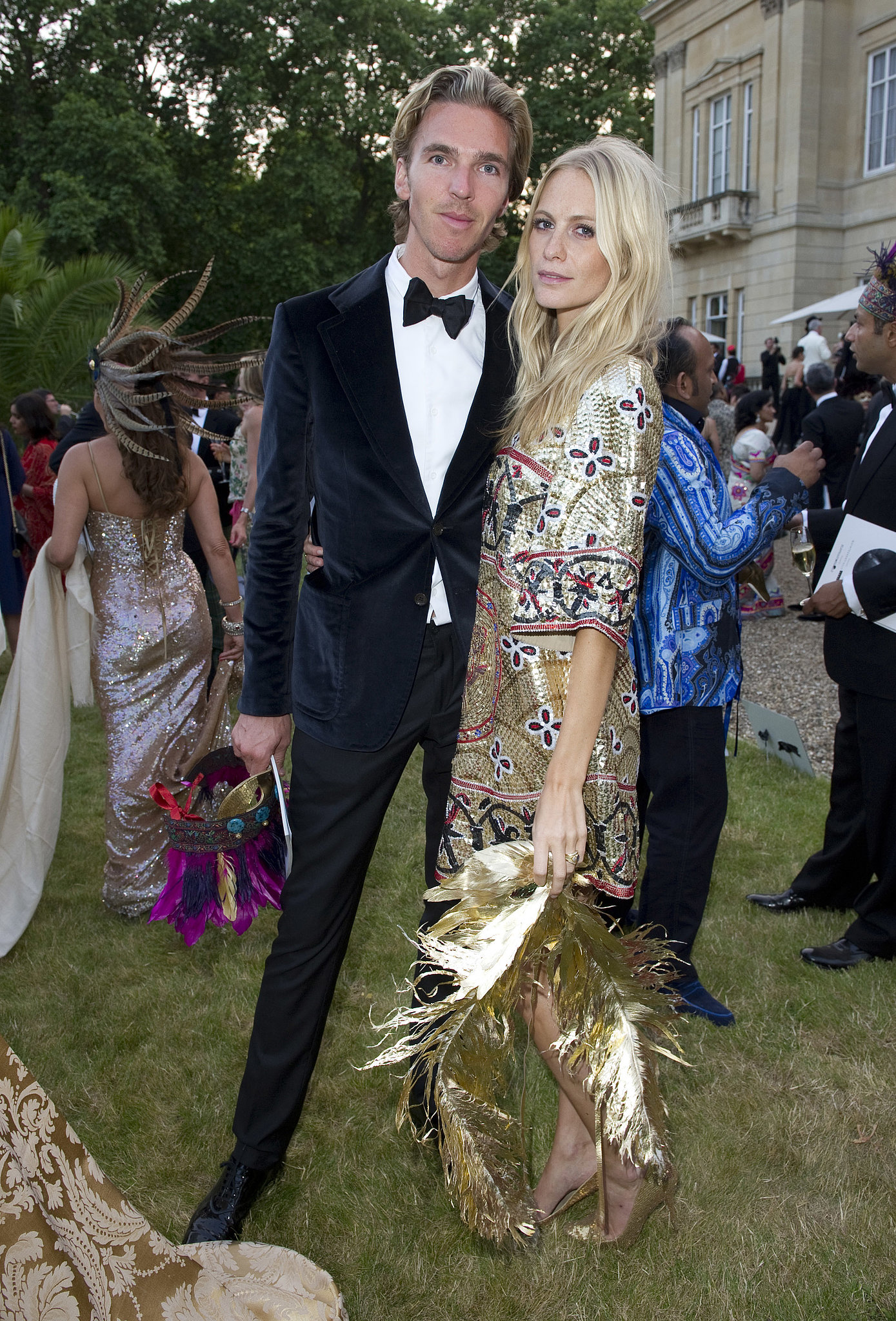 In keeping with The Animal Ball's theme, James Cook and Poppy Delevingne paired their ensembles with fe