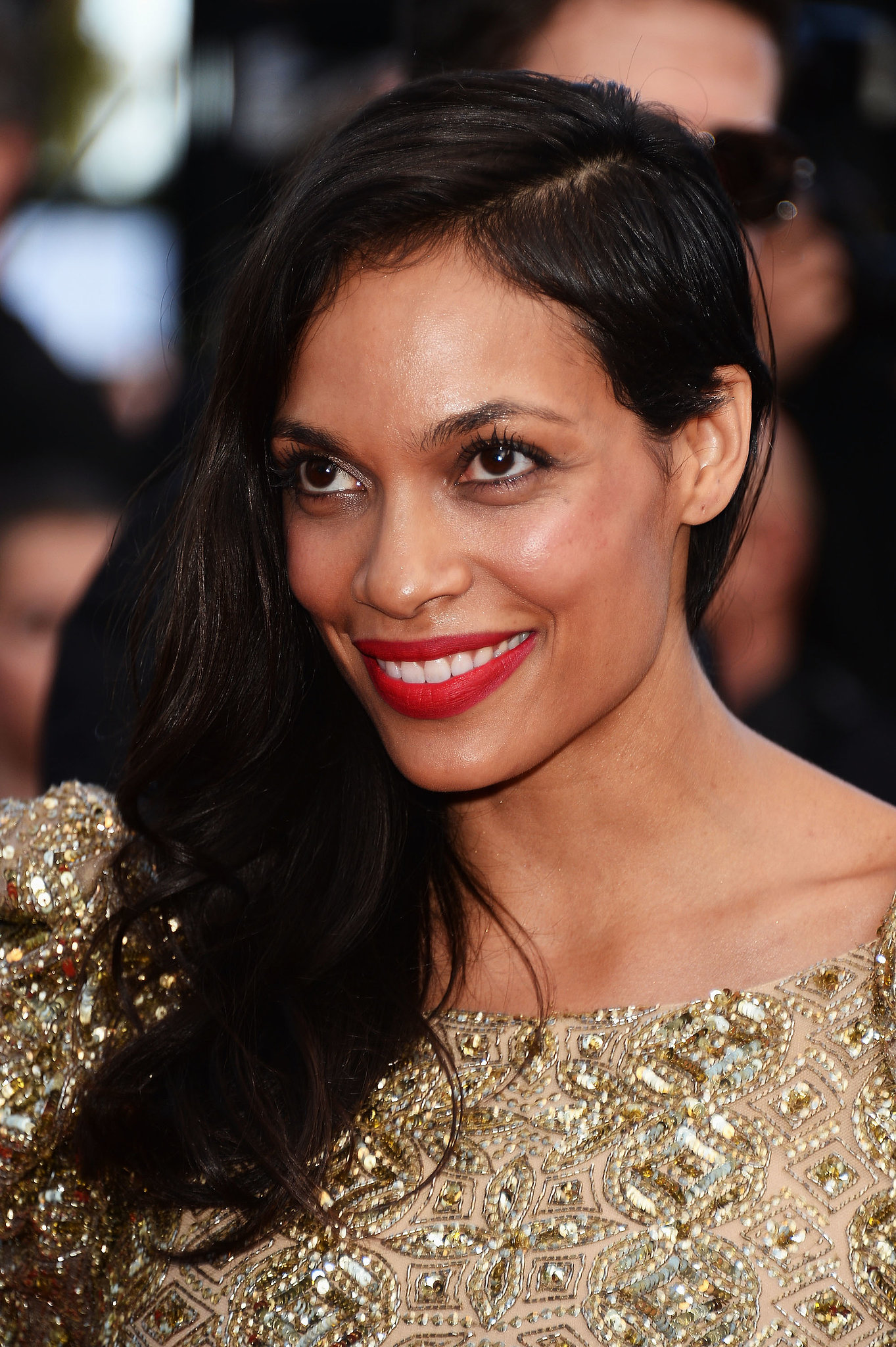 Rosario Dawson's buzzed sides are a touch longer than the norm, and are easily hidden with an opposite side part.