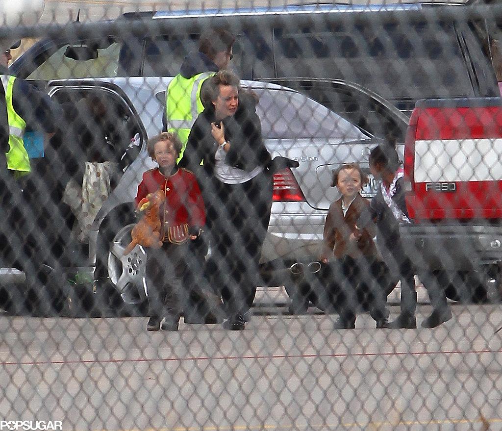 Shiloh Jolie-Pitt, Knox Jolie-Pitt, and Zahara Jolie-Pitt got a little help boarding a plane in Springfield, MO, in December 2010.