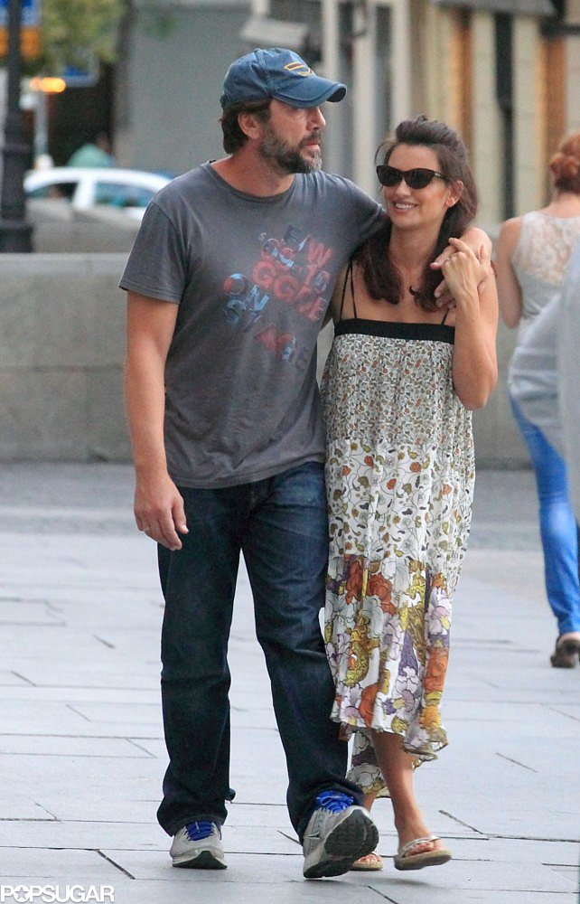 Penélope and Javier looked happy while walking down the street in Madrid in July 2012.