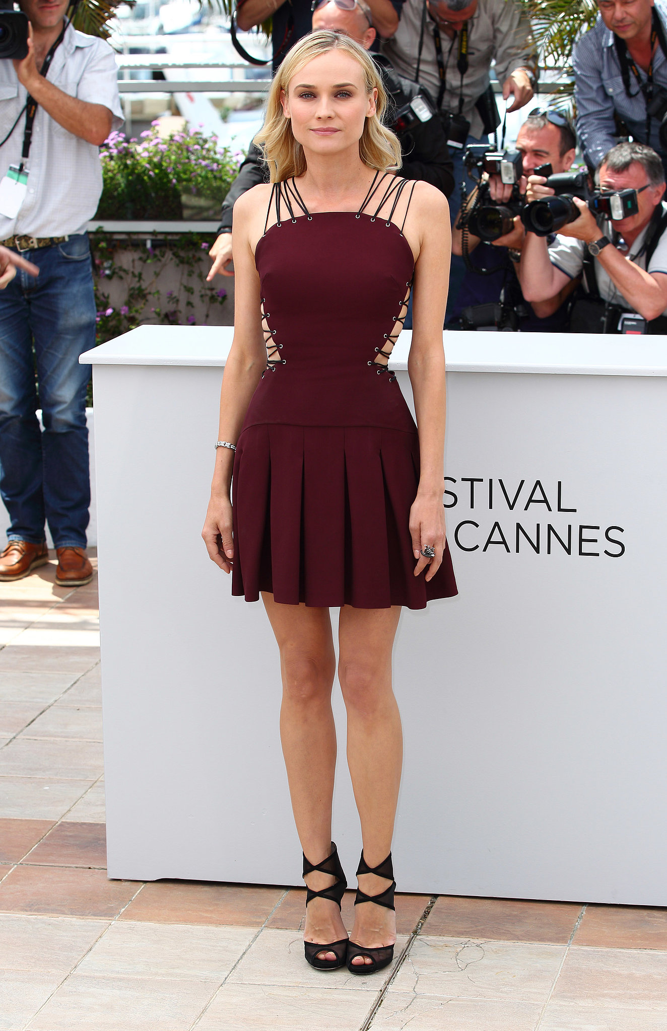 At the Cannes 2012 jury photocall, Diane wowed in a lace-up Versus pleated dress, paired with Jimmy Choo strappy platform sandals.