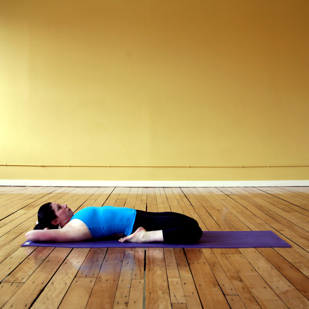 Reclining hero yoga sequence for an aching runner 39 s back for Floor quad stretch