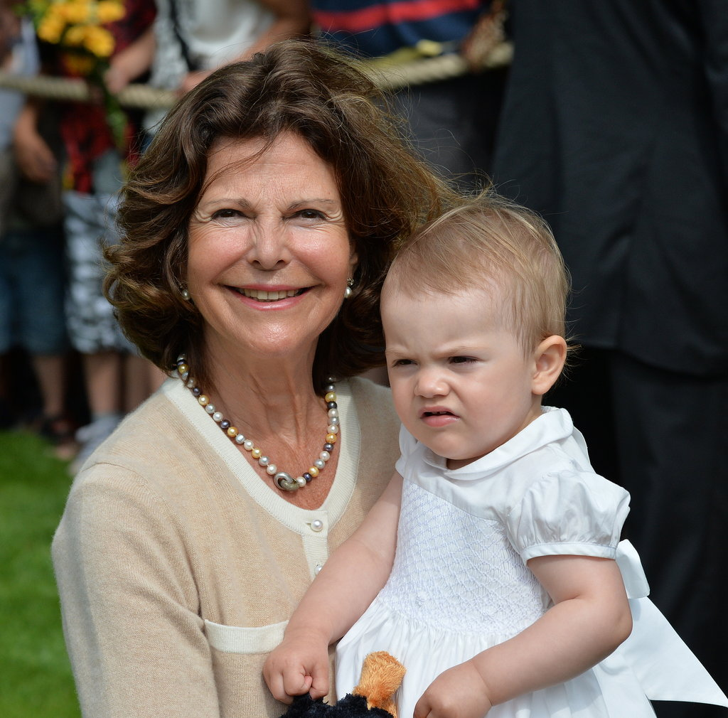 Queen Silvia held her granddaughter.