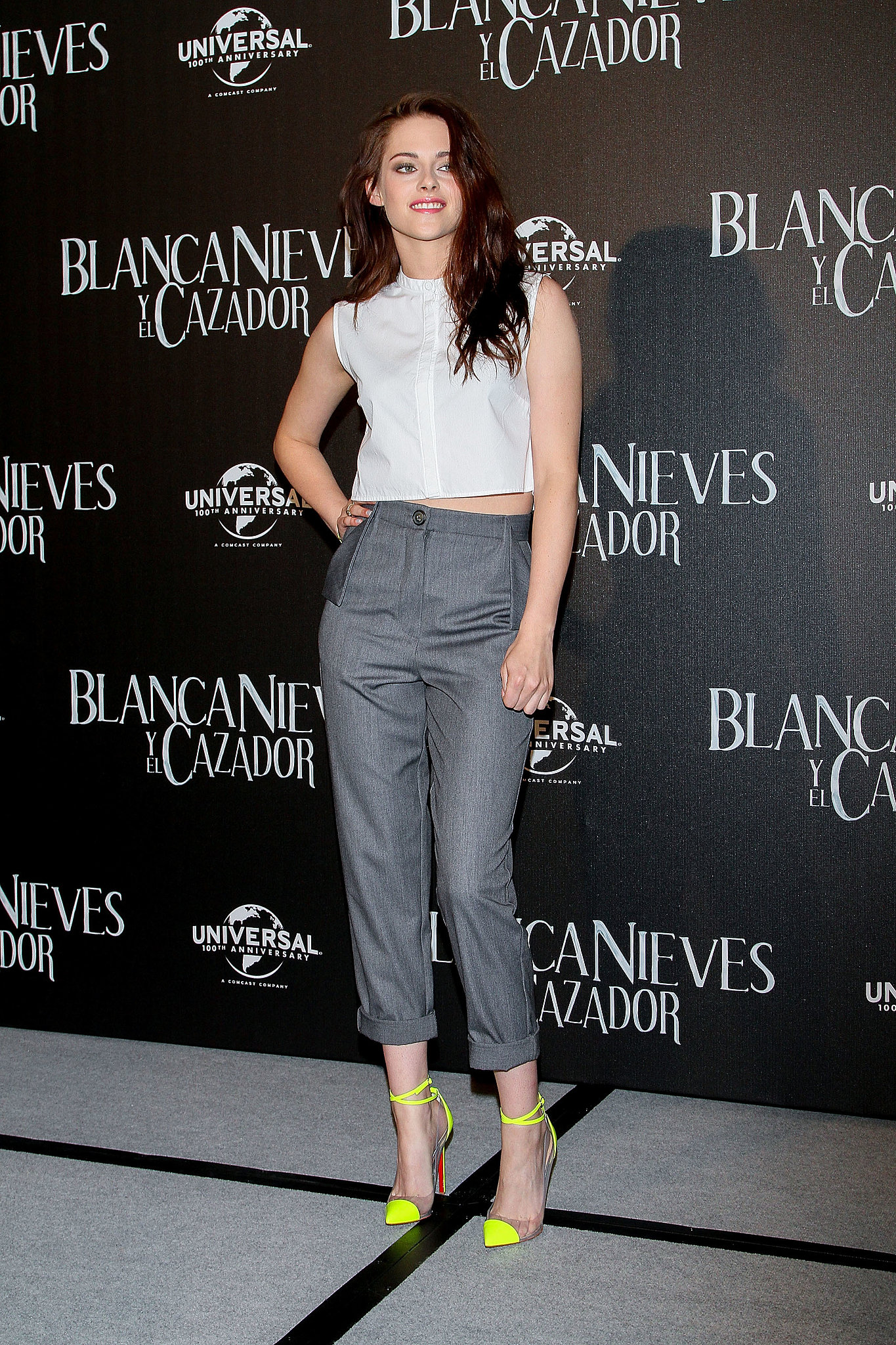 For a Snow White and the Huntsman 2012 press conference in Mexico City, Stewart posed in a menswear-inspired outfit: cropped white shirt by Marios Schwab, Vivienne Westwood gray cropped trousers, and a pop of color via neon Christian Louboutin ankle-strap heels.