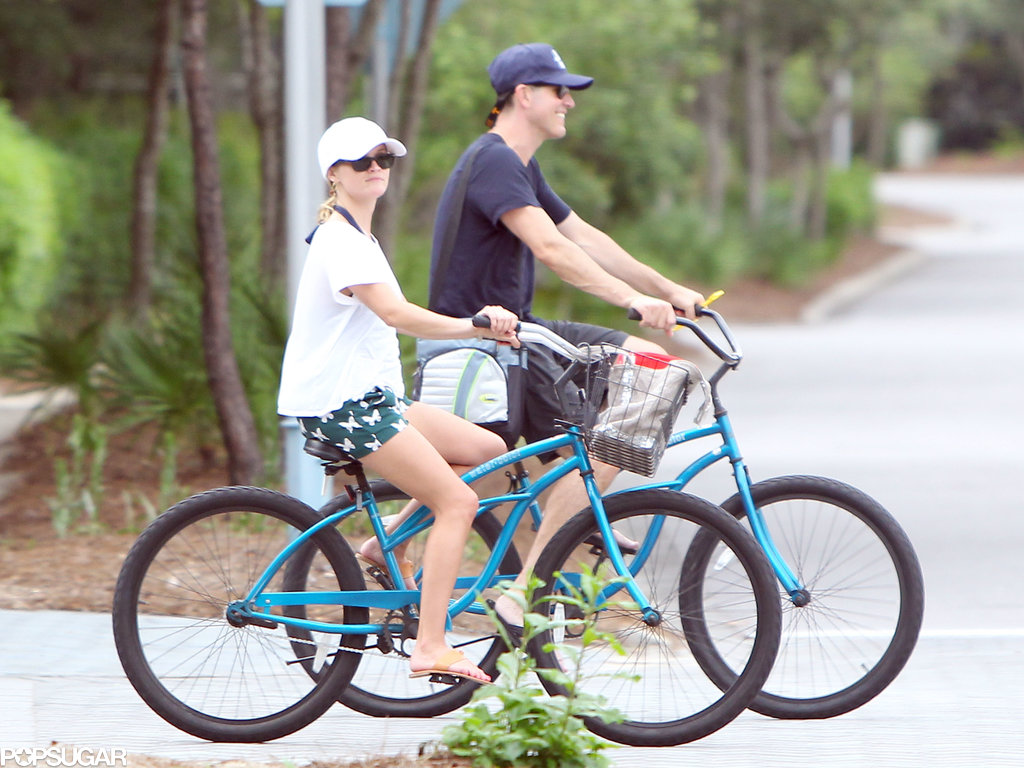 Jim Toth and Reese Witherspoon rode bikes around town.