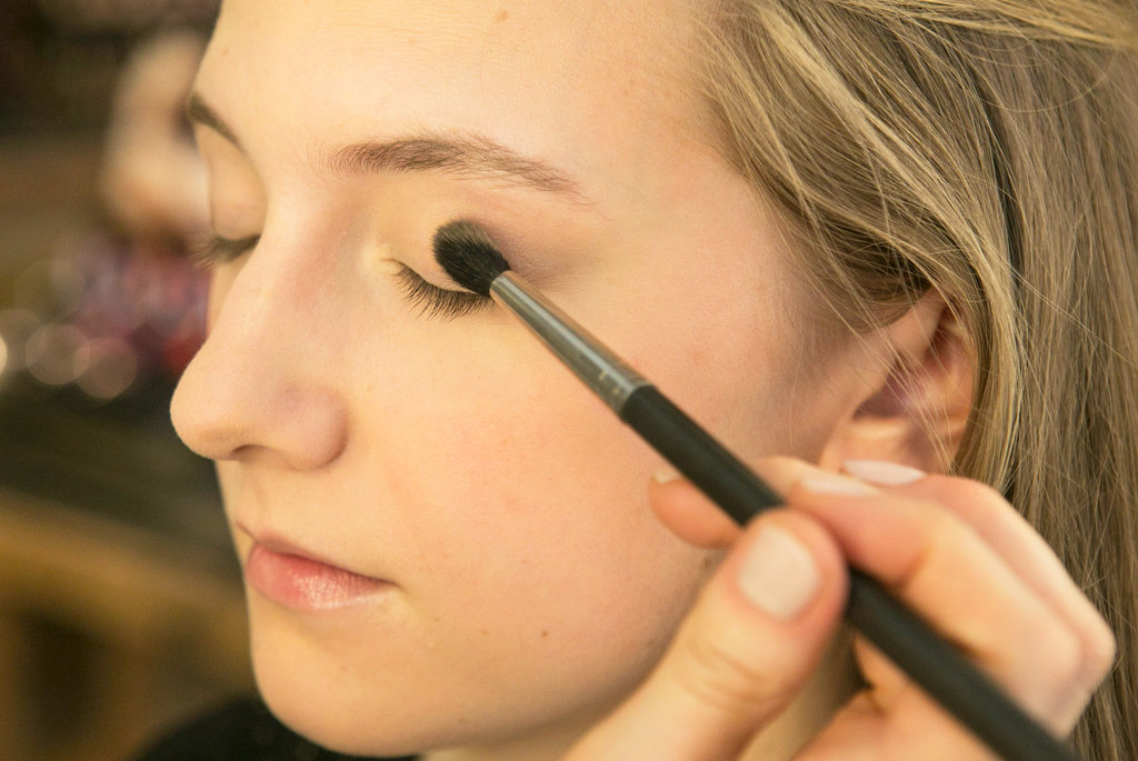 Heading back up to the eyes, Bettelli prepped the lids with Blot Powder ($26) to prevent greasy eyelids and eye shadow slippage. She then applied a warm tawny eye shadow — Pro Longwear in Always Sunny ($21) — all over the lids, connecting it under the lower lids as well.