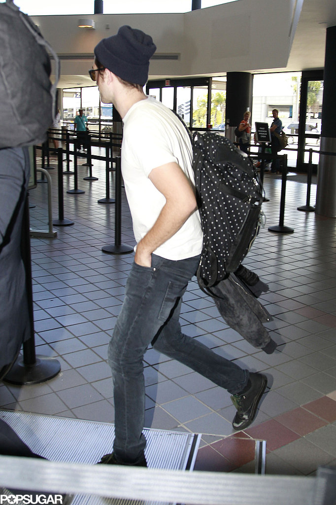 Robert Pattinson arrived for a flight at LAX.