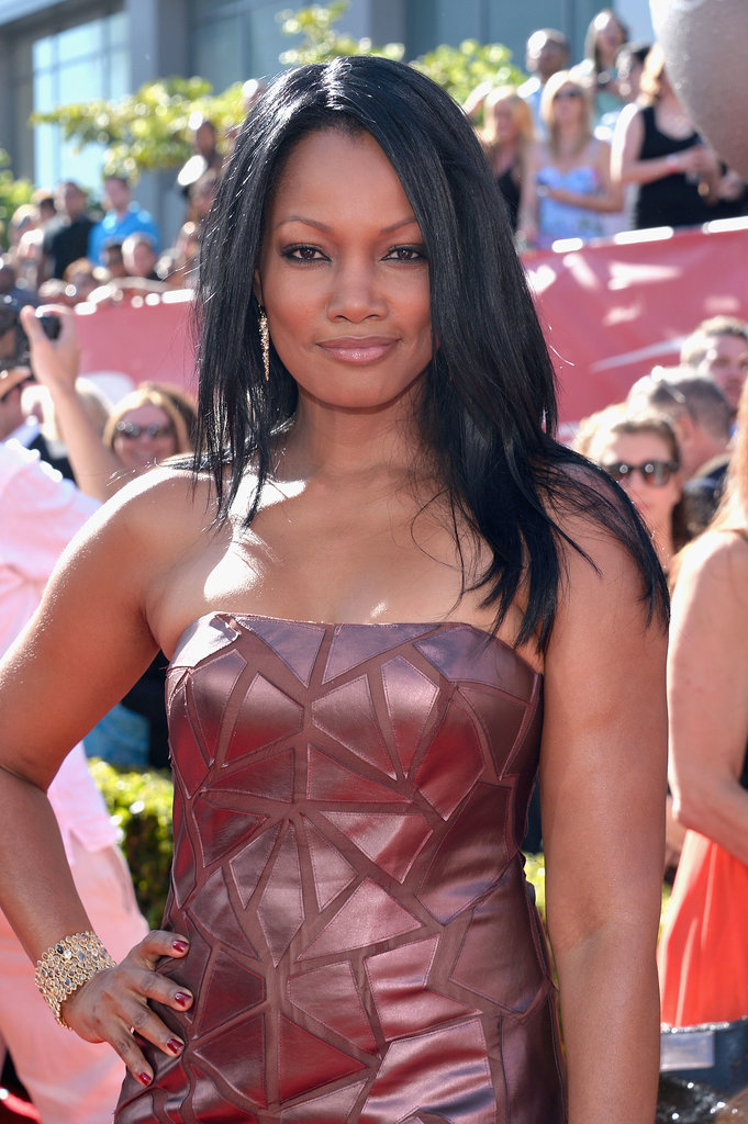 Garcelle Beauvais kept it simple with straight hair, black eyeliner, and a neutral lip gloss.