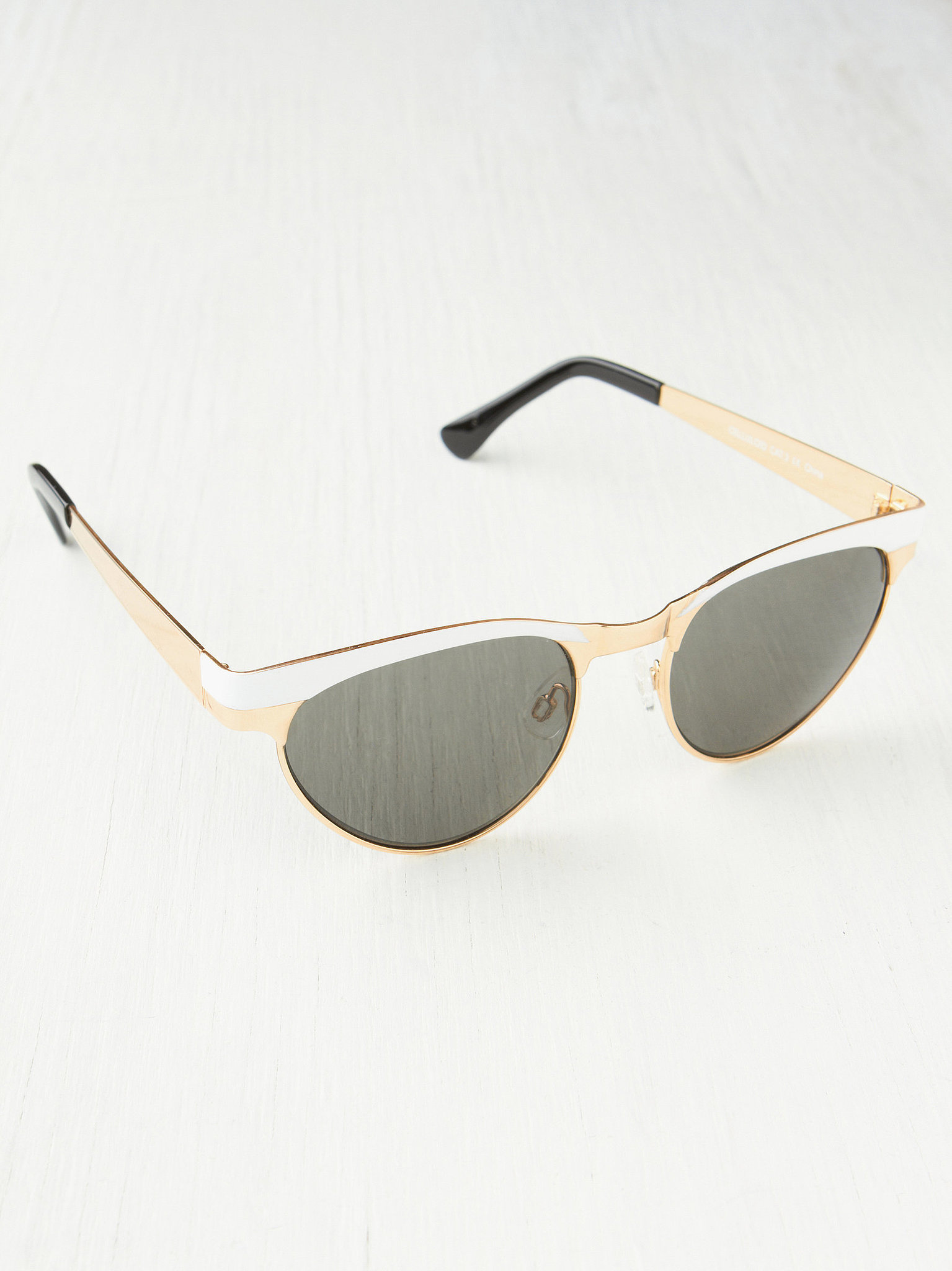 Old-school glam lovers should face the sun in this gold-rimmed Free People pair ($38).
