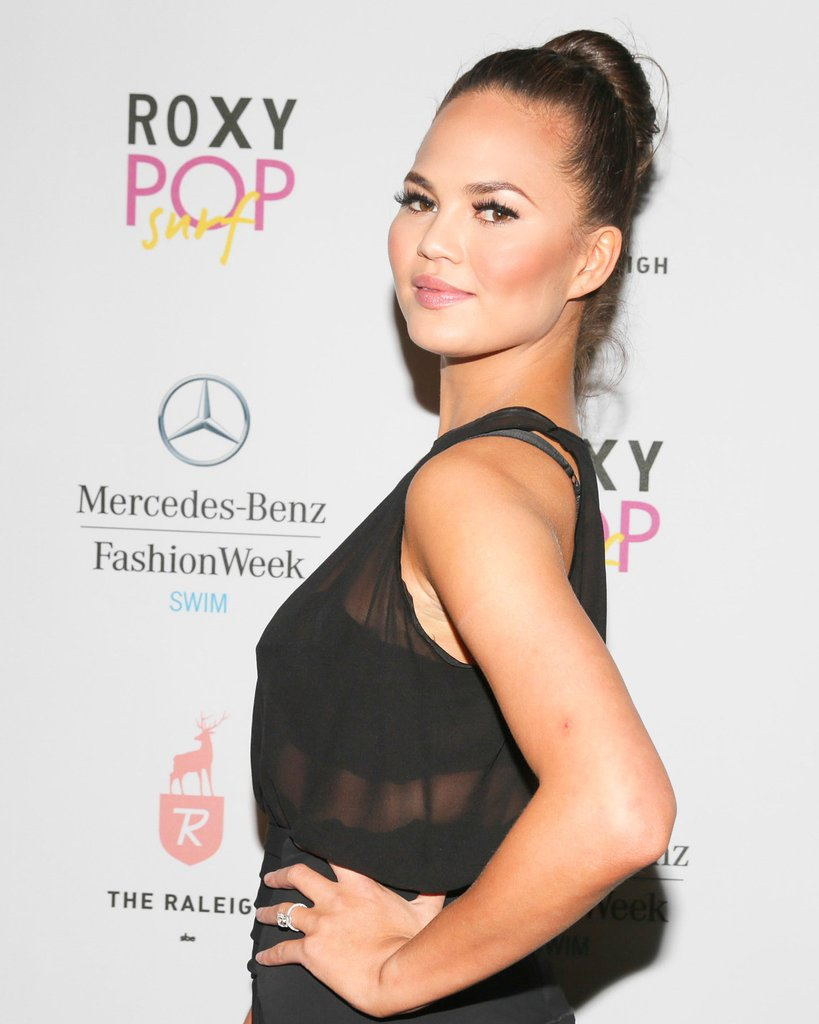 To kick of Miami Swim Week, Chrissy Teigen also chose a topknot hairstyle and a full set of lashes.