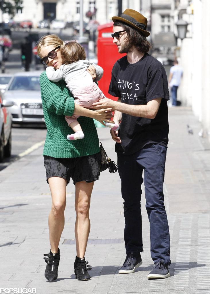 Sienna Miller handed her daughter to Tom Sturridge.