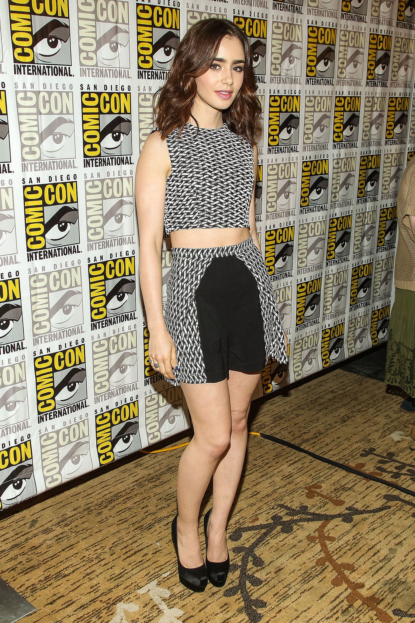 Lily Collins wore a top and shorts by Paper London and a ...