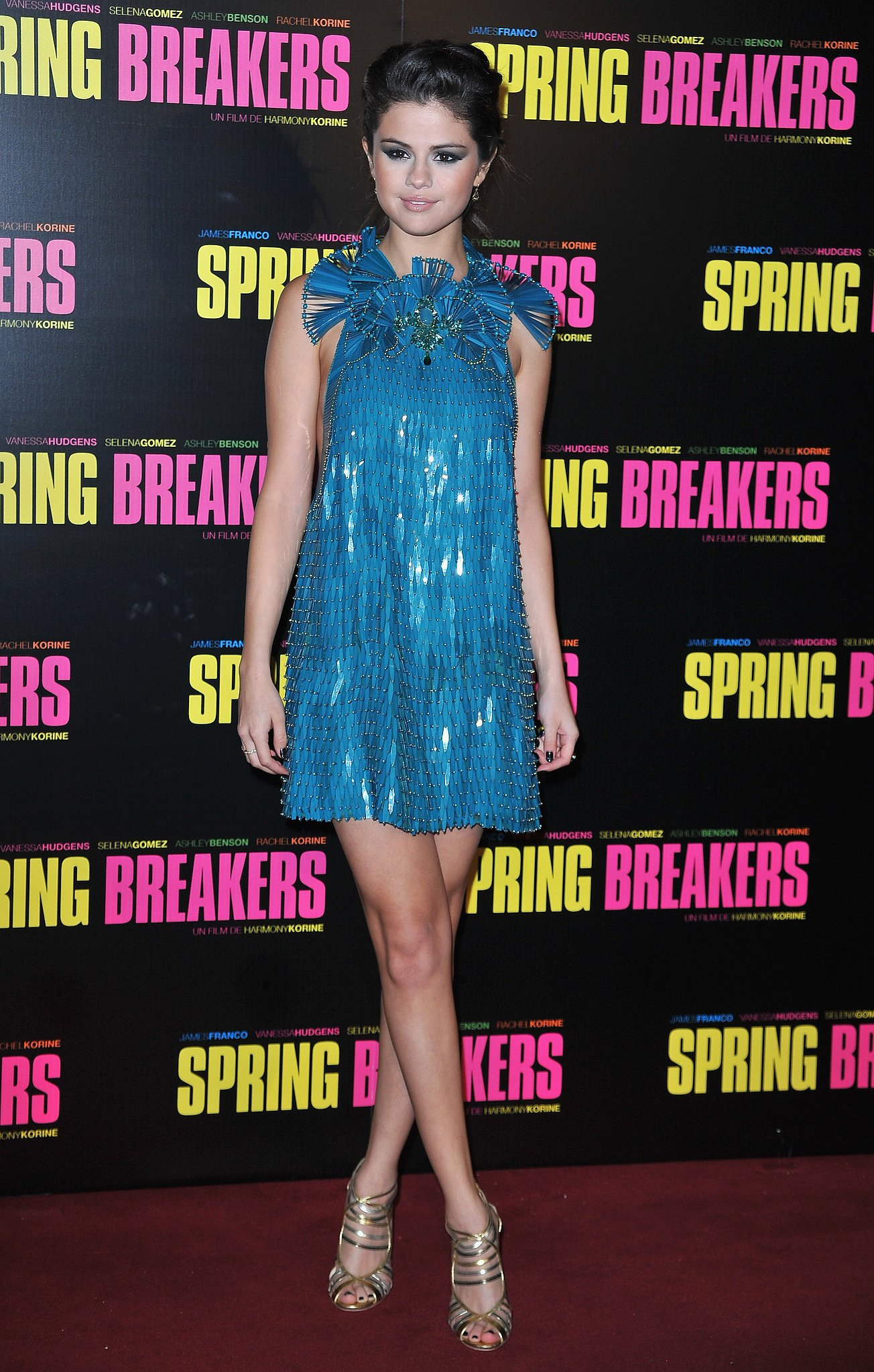 For the Paris premiere of Spring Breakers, Gomez dazzled in a turquoise sequin Gucci mini complete with a fanned ruffle collar and extra beaded embellishments.