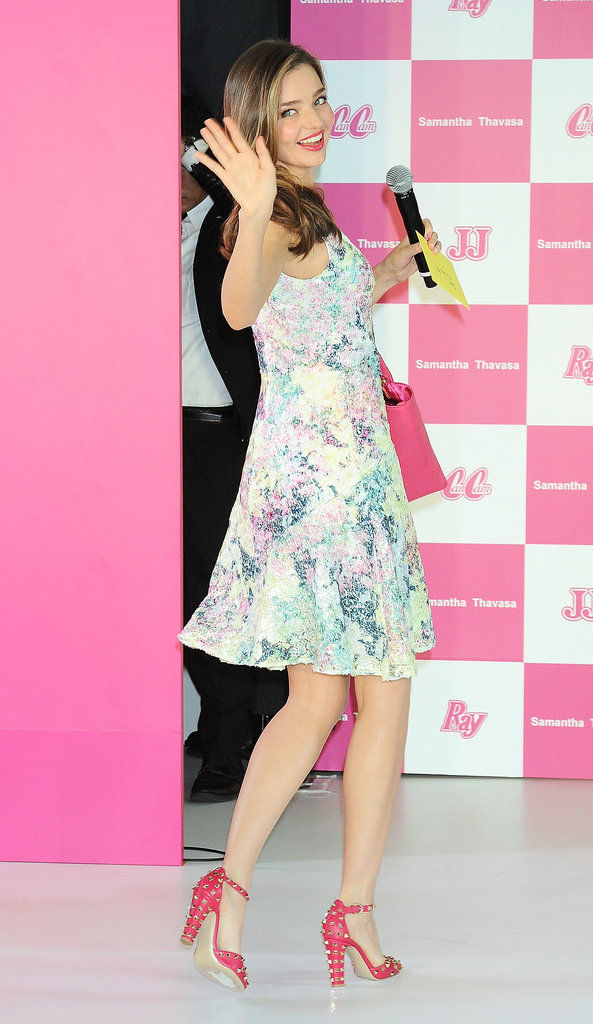 Miranda Kerr waved to fans at a press conference in Tokyo.