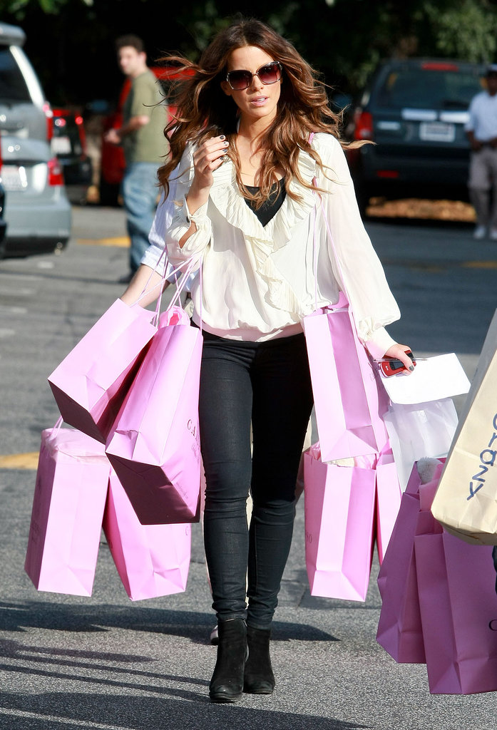 Kate had her hands full during a December 2010 shopping trip in Brentwood, donning a gauzy ruffle-trim blouse and dark denim.