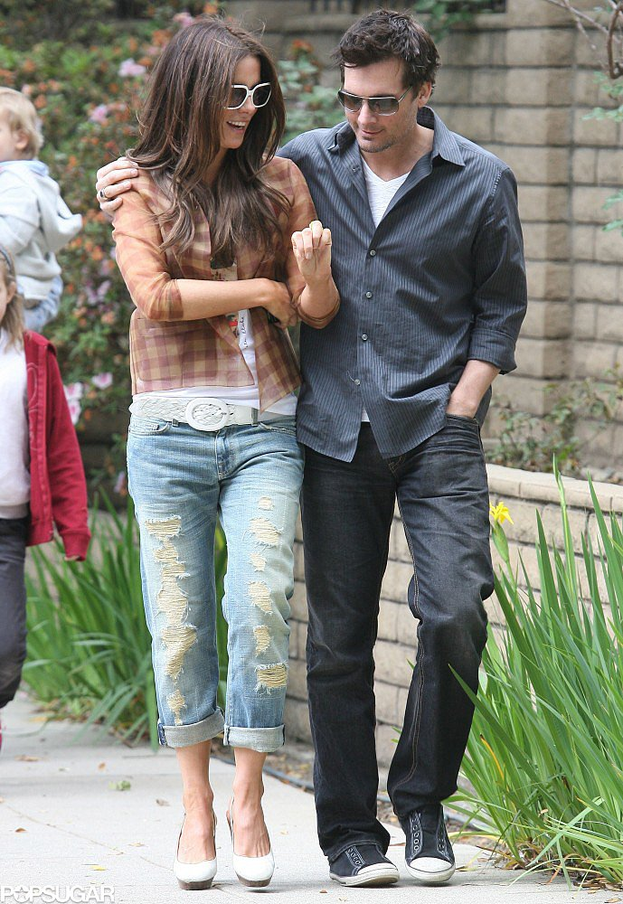 Kate Beckinsale dressed down in shredded Current/Elliot boyfriend jeans and a silk flannel shirt, layered over a white graphic tee, for an afternoon in LA with her husband in April 2009.