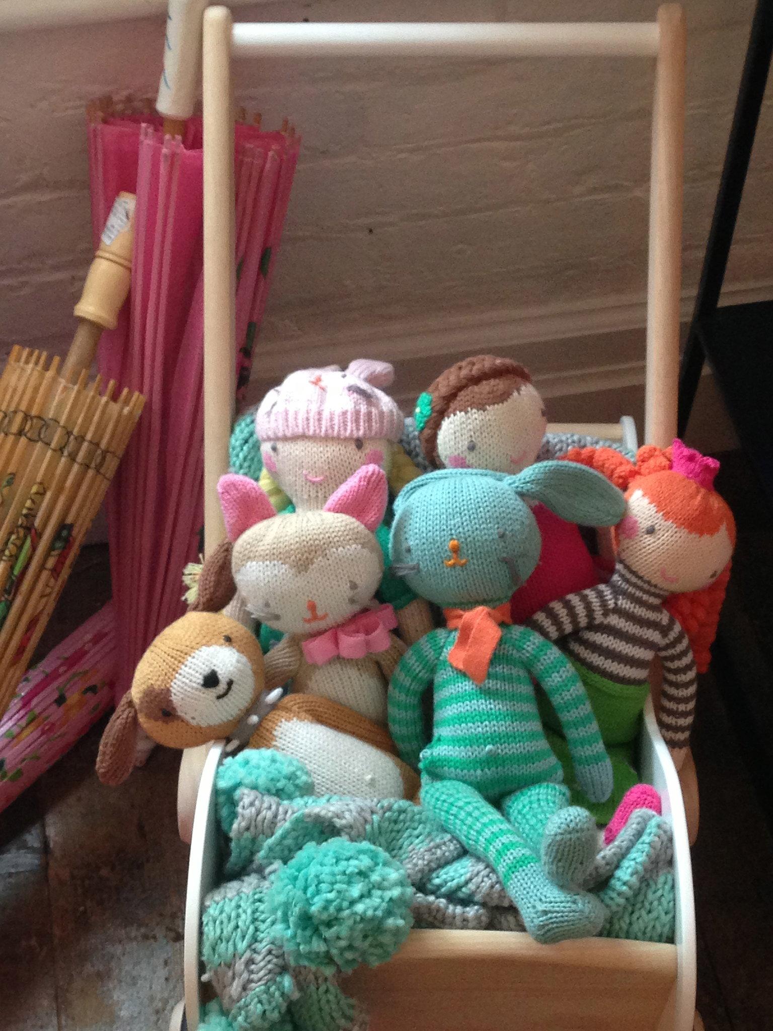 A pretty, minimalist stroller full of knit friends.