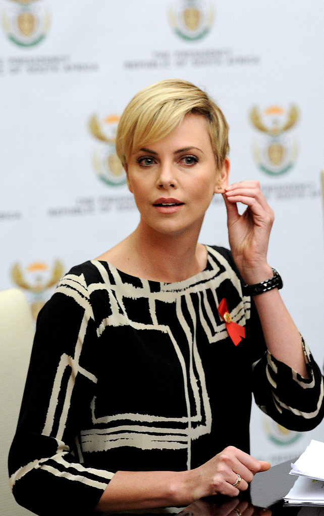 Charlize Theron showed off a new haircut during a press conference in Pretoria, South Africa.