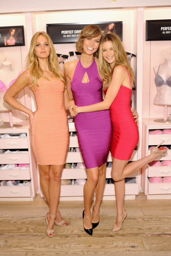 Erin Heatherton, Karlie Kloss, and Behati Prinsloo all rocked bandage dresses in different colors at the Victoria's Secret Body by Victoria launch in NYC.