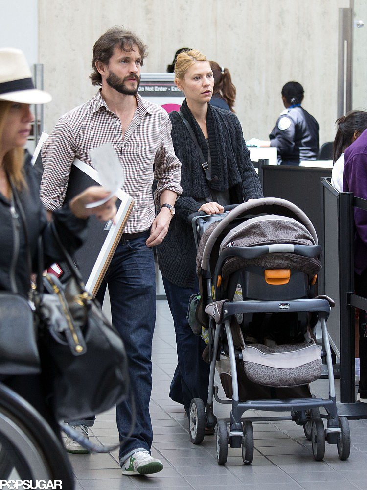 Claire Danes traveled out of LAX with her husband, Hugh Dancy, and her son, Cyrus.