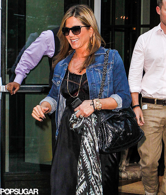 Jennifer Aniston wore a denim jacket leaving the Crosby Street Hotel in NYC.