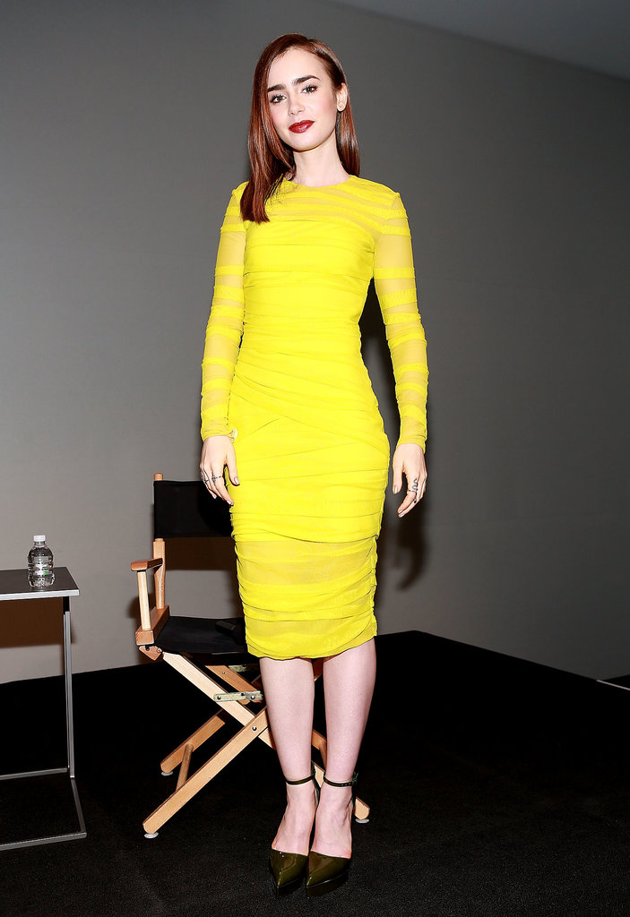 Bright stuff coming through — Lily Collins lit up the stage in a yellow sheath and Casadei heels at Apple's SoHo store.